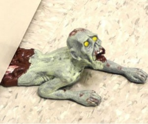 Zombie Door Stop: What better way to stop your doors than with a crushed and mutilated zombie?
