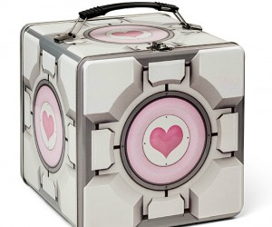 Protect your lunch with love in this durable and adorable, uh, adurable… Companion Cube tin lunch box.
