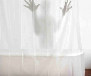 Transform your bathroom into a horror movie scene with this scary shadow shower curtain.