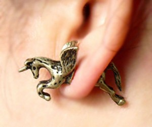 "3D Unicorn Earrings  – It""s like a unicorn is flying right through your ear!  (looks kinda painful.)"