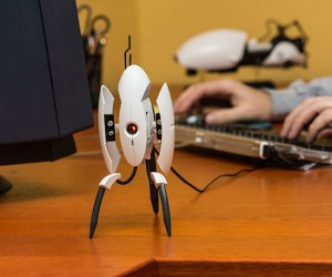 This motion detecting turret will open and alert when someone comes by your desk!